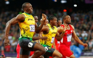 Jamaica's Bolt leaps ahead to win the men's 100m final past Blake and Gay during the London 2012 Olympic Games at the Olympic stadium in London